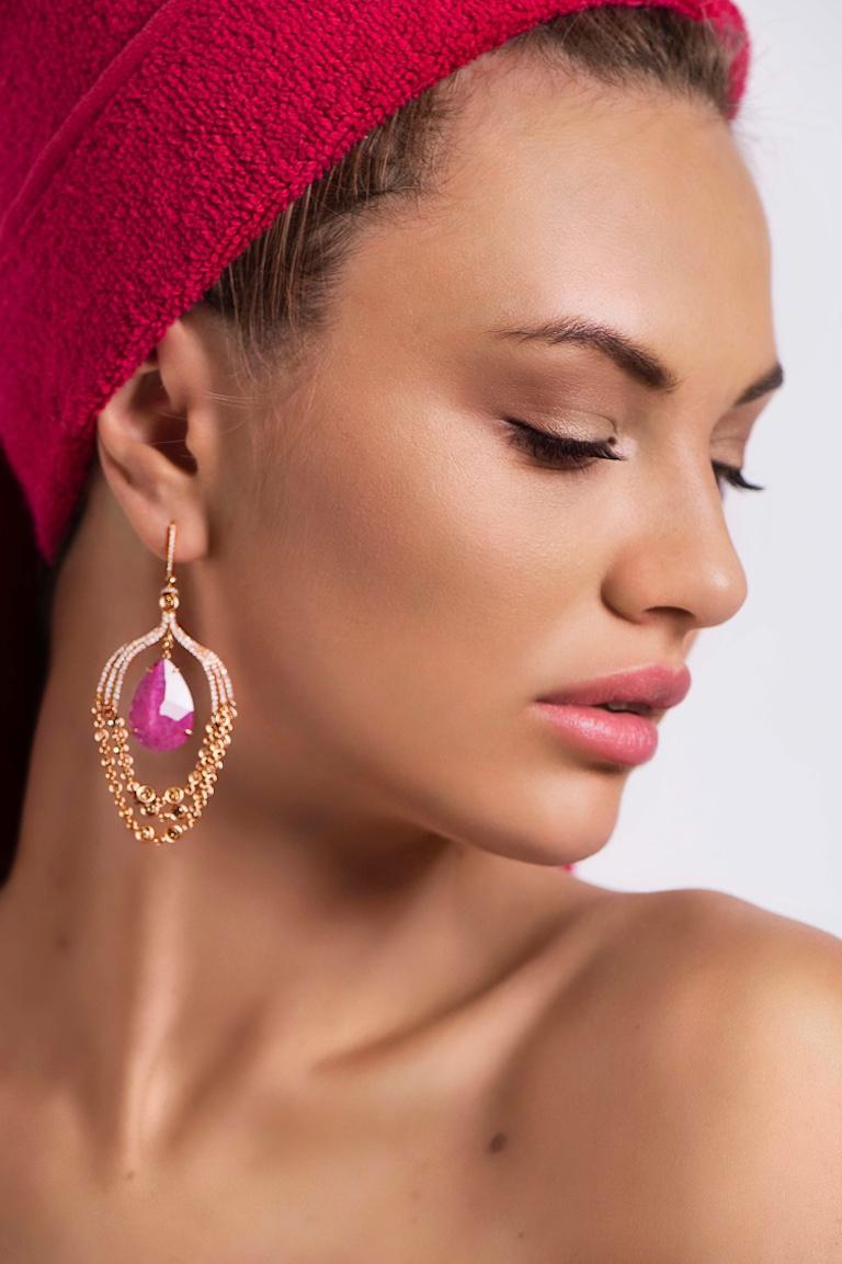 Gentle pink tourmaline set in bright rose gold is an example of real femininity and sparkling youth. Shining beauty and elegance are the extra effects you get with these earrings to complement your  natural allure.  Diamond 14-RND-1.14