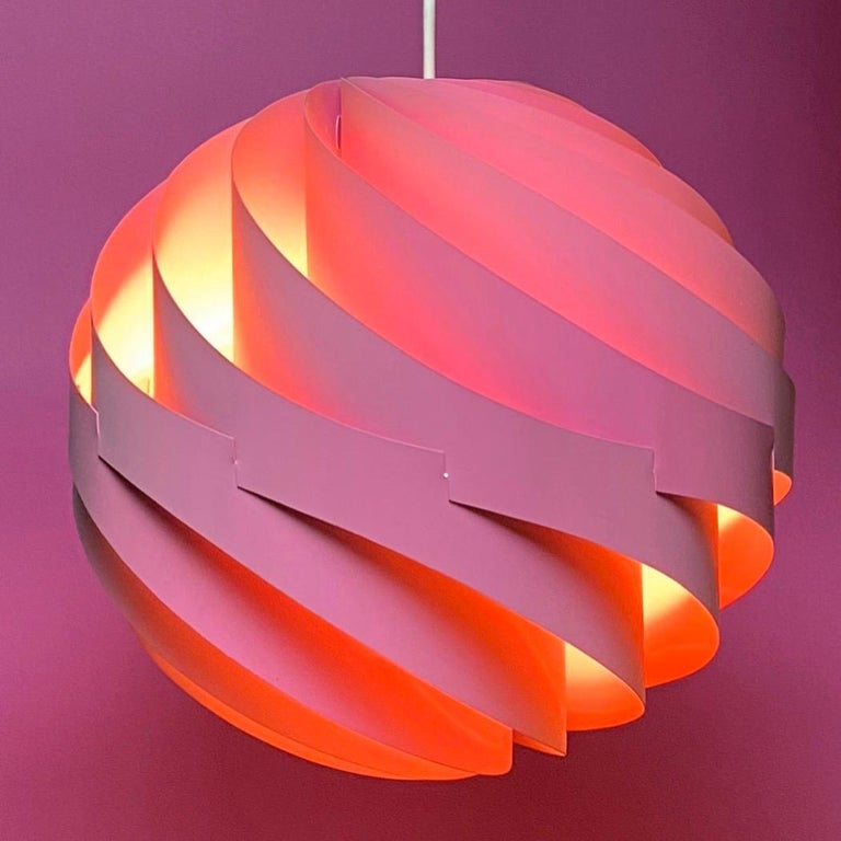 The original Turbo ceiling light was made in white, orange and this pink lacquered version in 1967 by Louis Weisdorf for Lyfa, Denmark.  Weisdorf is known for some of the most beautiful Danish lighting designs and the Turbo is no exception. From all