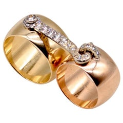 "Pink, Yellow, and White Gold Diamond ""Hook and Eye"" Pair of Wedding Bands"
