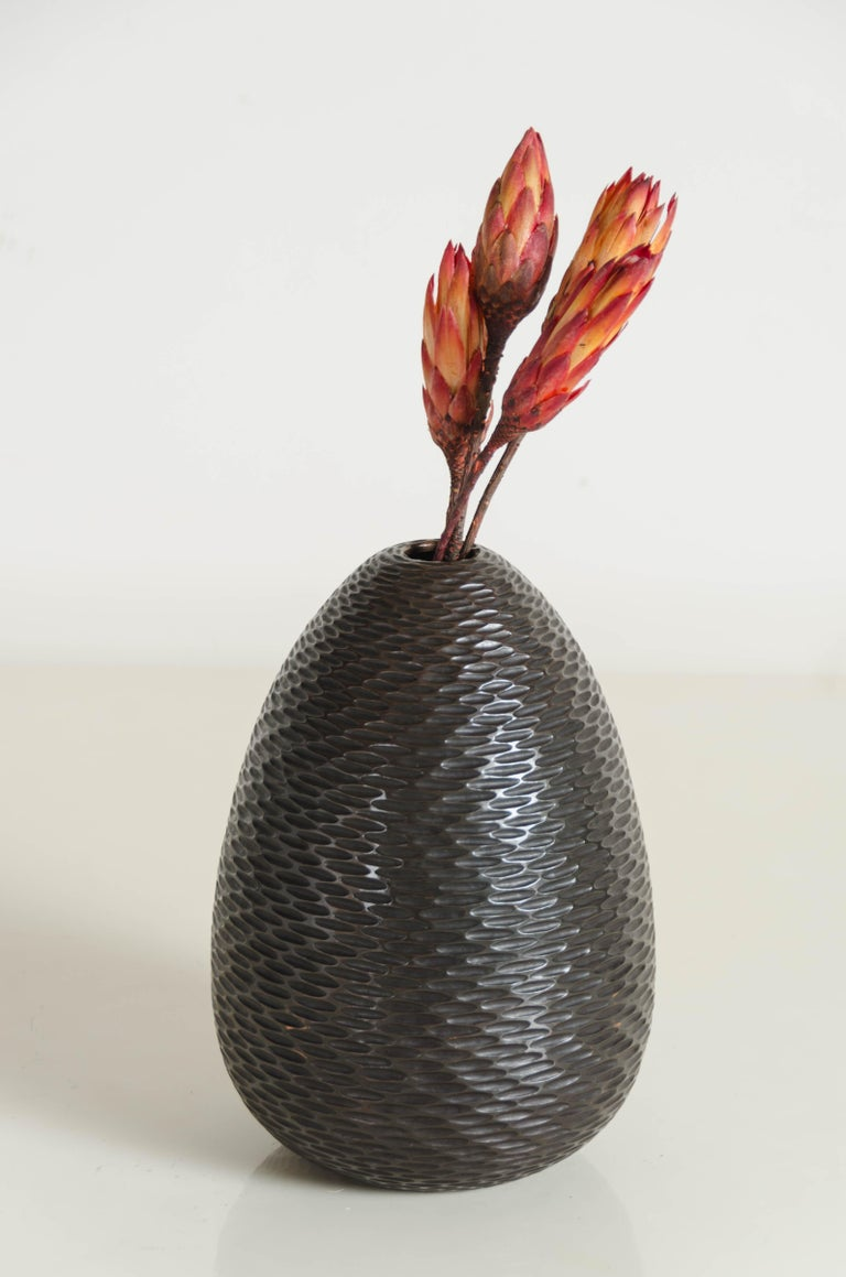 Pino vase Antique copper finish Hand repousse Limited Edition  Repoussé is the traditional art of hand-hammering decorative relief onto sheet metal. The technique originated around 800 BC between Asia and Europe and in Chinese historical