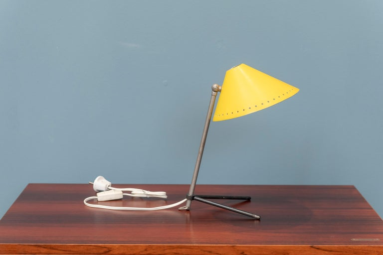 Elegant and stylish table or wall lamp for Dutch lighting company Hala. Tripod base adjustable in height and angle. Minimalistic, beautiful and well thought out designed lamp in very good original condition.