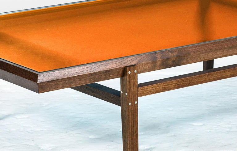 American Pintor Coffee Table, Walnut Frame with Stainless Steel Inlay, Orange Glass Top For Sale