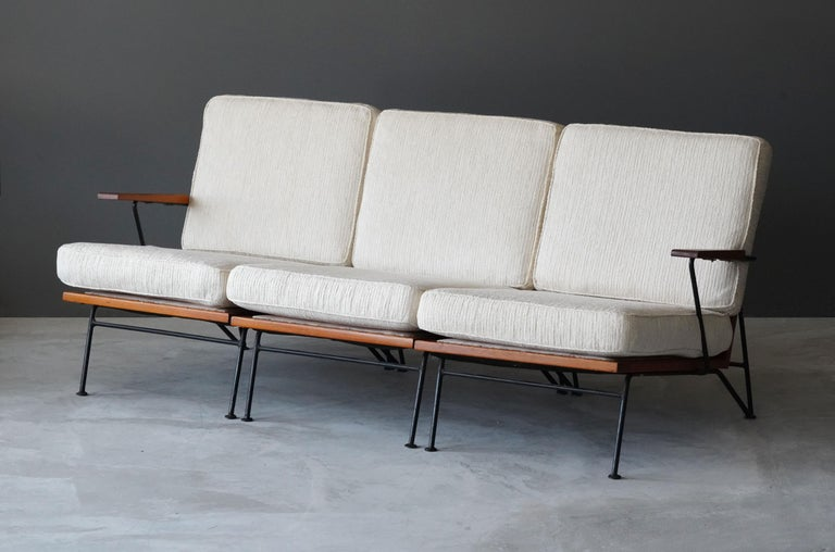 """A sofa designed by husband and wife duo Pipsan Saarinen Swanson & J. Robert F. Swanson. Designed by their firm Swanson and Associates as part of the """"Sol-Air"""" line for Ficks Reed Company, Cincinnati in 1949.   The line was showcased at the 1950"""