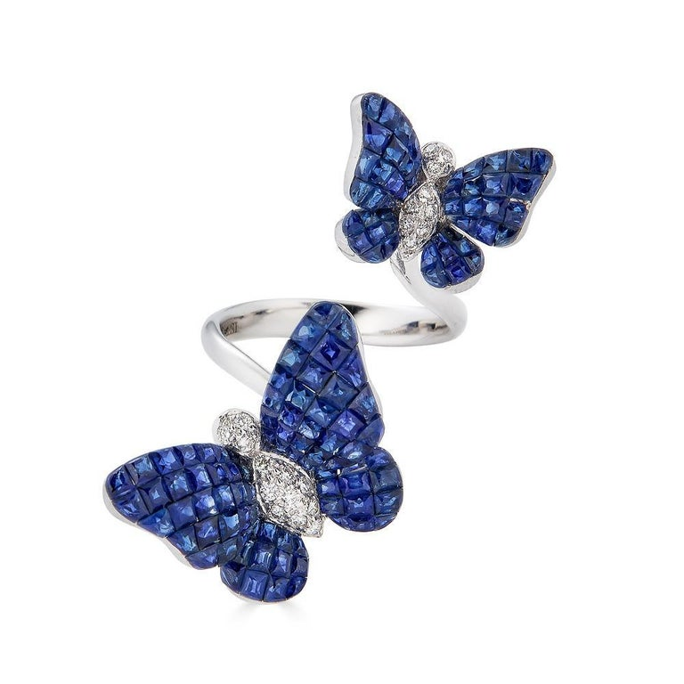 Piranesi Invisible set Farfalla double ring in 18K white gold with diamonds  approx. 12.85 carats Invisible Set Square Blue Sapphires 0.17 carats Round Diamonds Ring set in 18K White Gold  Disclaimer: Please note: All carat weight is approximate and