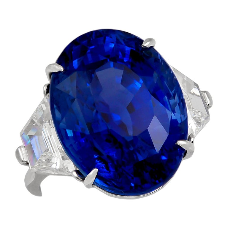 The oval-shaped ceylon sapphire weighing 29.83 carats, flanked by two trapeze diamonds weighing approximately 2.00 carats, size 5¾, signed Piranesi.  Sapphire comes with GIA certificate. Condition: Good - Previously owned and gently worn, with