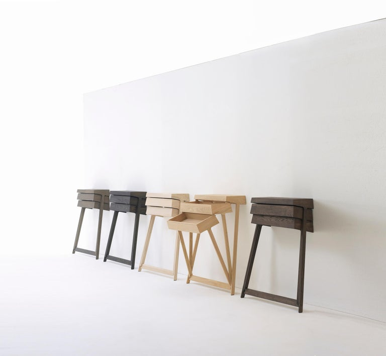 Pivot is a solid wood cabinet which is built on tall legs and features two drawers. The innovative aspect of this cabinet is the fact that the drawers can hinge, making it possible to open both drawers at the same time, which is impossible with a