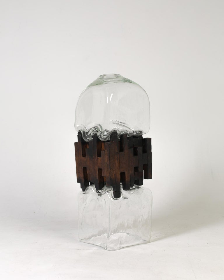 Pixel vase middle oak by Drozhdini Dimensions: 80 x 23 x 23 cm Materials: Glass, oak  Handcrafted by blowing with a glass tube. Glass was molded on uniformly fading, oak, as a result of which the moment of contact of plastic living glass matter