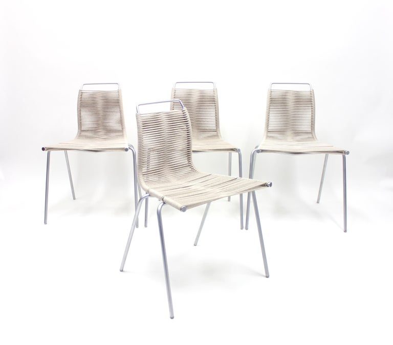 Set of four PK1 chairs designed by Poul Kjærholm and recently manufactured under licence by Thorsen Møbler in Denmark. Aluminium frame with rope seat and back. Very good condition.