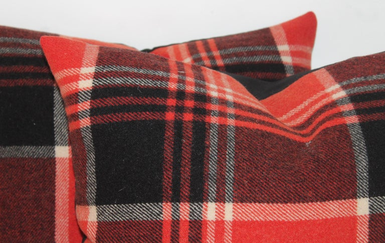 These burnt orange and black wool blanket pillows are in fine condition. The have black cotton linen backings. The inserts are down and feather fill. Two pairs only in stock.