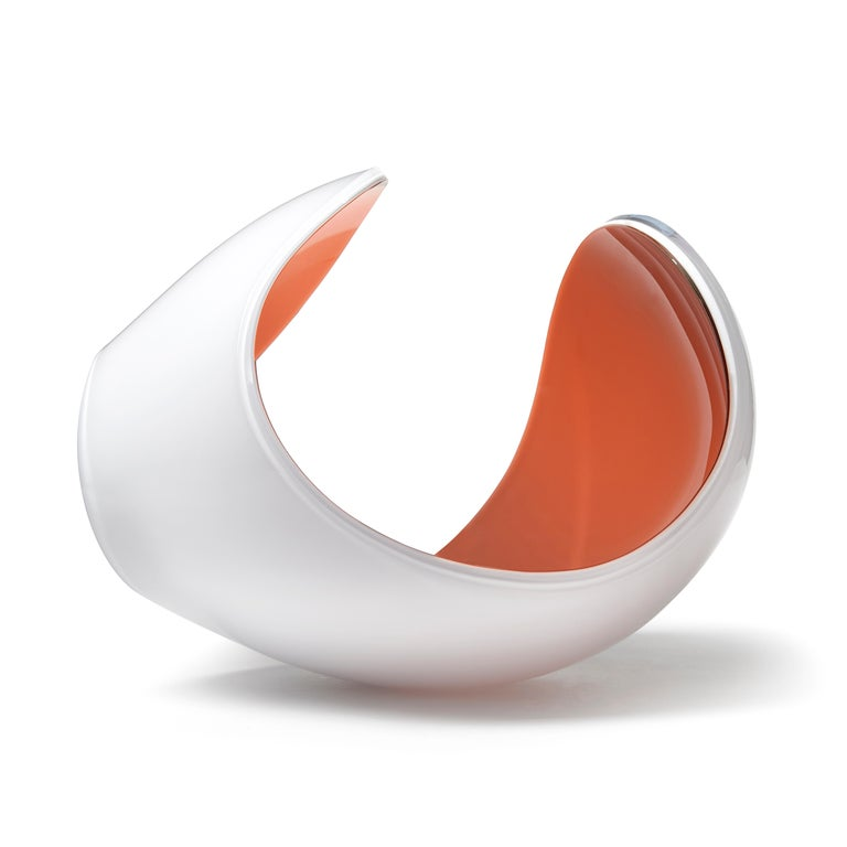 Planet in White and Peach is a unique glass sculptural artwork and centrepiece by the Swedish artist Lena Bergström. This piece is from an ongoing collection of works called the Planets which the artist has revisited several times throughout her