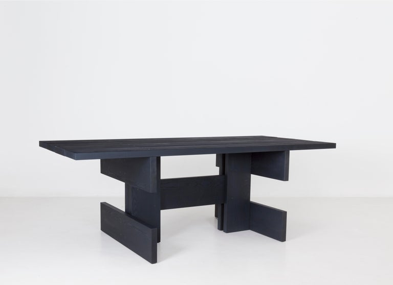 A bold wooden dining table. All its elements: base, legs, tabletop are based on the same plank profile and then linked. The constructed character gives Plank a rather architectural appeal. It sits like an anvil in the room and thanks to its