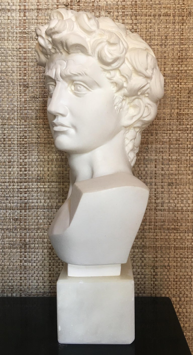 """Giuseppe Bessi (1857-1922, Italy) Highly detailed plaster composite bust sculpture of David mounted on an alabaster/marble plinth base. Signed on the back """"Prof. G. Bessi"""".   Giuseppe (Professor) Bessi was an Italian sculptor famed for his lifelike"""