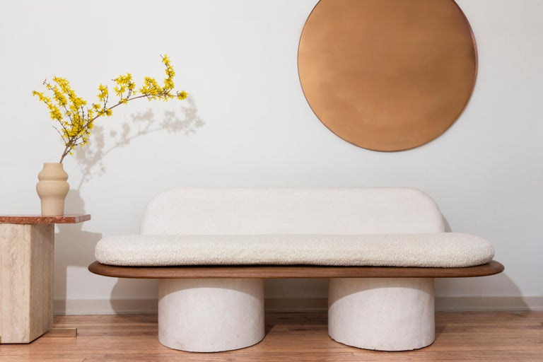 The Pillar sofa by Jackrabbit Studio is an elegant, minimal piece comprised of a hand-plastered back and base with a thin black walnut seat and bouclé upholstered cushion. Drawing inspiration from architectural elements like plastered walls and