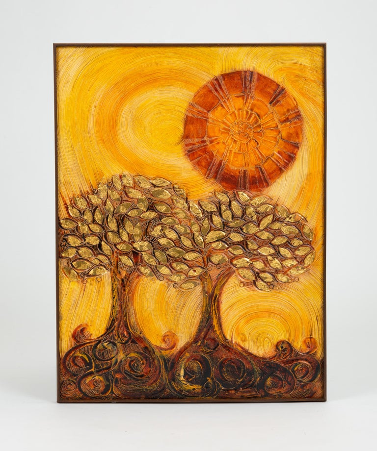 A large scale pastoral scene rendered in plaster relief, with paint and gold leaf applied, depicting two trees with curling roots in the foreground with an abstractly geometric sun shining above. The materiality of the plaster lends a sense of