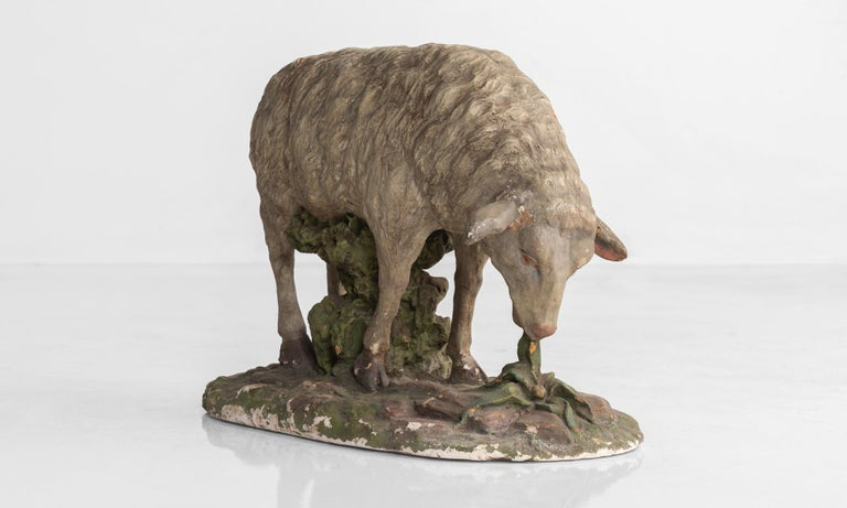 Plaster sculpture of sheep, circa 1950  Painted, playful sheep, cast in plaster.  Measures: 13.5