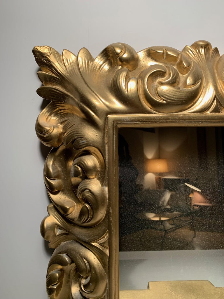 Plaster wall mirror Hollywood Regency. Originally a white plaster. This one was recently painted gold. Can easily be painted white over the gold if desired. A picture is included showing how these frames look in white. In the manner of Serge Roche