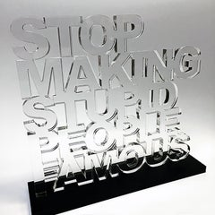 """Stop Making Stupid People Famous"" - Clear Acrylic Sculpture with Black Acrylic"
