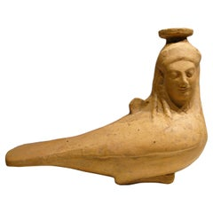 Plastic Terracotta Vase in Form of a Siren. Eastern Greek, circa 530 BC