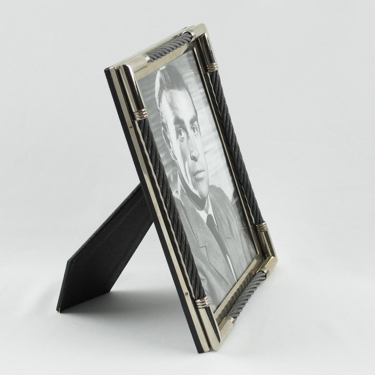 Elegant picture photo frame by Plata Lappas SA, Argentina. Very chic design with silver plate framing ornate with stainless steel cable. Marked on edge: Plata Lappas SA - made in Argentina. Back and easel covered with textured black paper. The