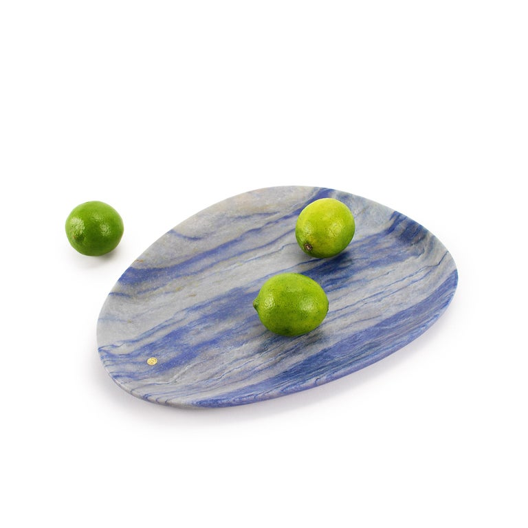 Hand carved presentation plate from semi-precious quartzite Azul Macaubas. Multiple use as plates, platters and placers. Dimensions: Medium L 30, W 28, H 1.8 cm, also available: Big L 36, W 35, H 1.8 cm, small L 24, W 20, H 1.8 cm.  Pieruga proudly