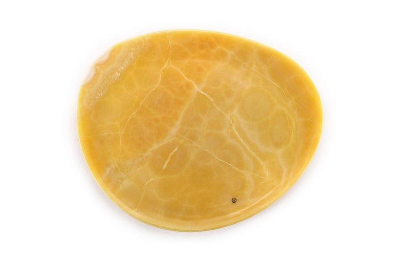 Hand carved presentation plate from orange onyx. Multiple use as plates, platters and placers. The polished finishing underlines the transparency of the onyx making this a very precious object. Dimensions: Big - L36 W35 H1.8 cm, also available:
