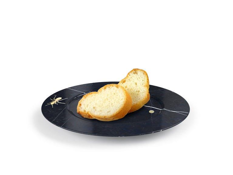 Bread and butter plate. Hand carved circular plate from Marquinia Marble with inlaid brass ants. Polished finishing. Multiple use as plates, platters and placers. Dimensions: D 18, H 1.5 cm  Pieruga proudly creates elegant accessories and