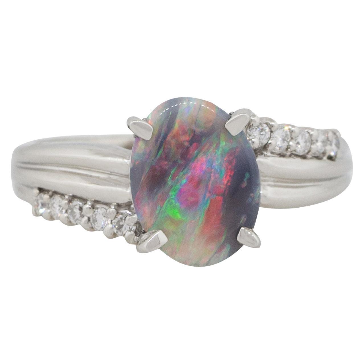 Platinum 0.16 Carat Diamond Black Oval Opal Cocktail Ring
