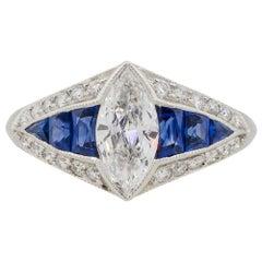 Platinum 0.80 Carat Marquise Diamond Center Ring with Sapphires