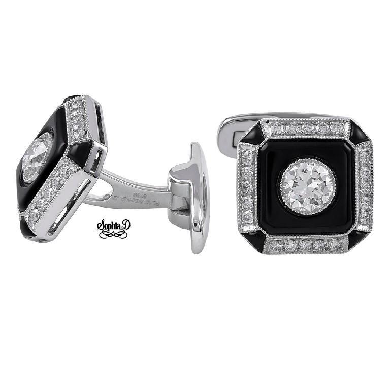 Platinum Set Cufflinks with Center Round Diamond Weighing 0.87 Carat and Surrounding Diamonds Weighing 0.41.