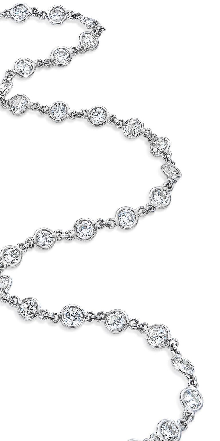 Elegance at its best! A true forever necklace. Gorgeous alone, layered, day to night! 54 round brilliant bezel set diamonds @ 3.80 mm all around= 11 Carat (approx). Custom platinum diamonds by yard setting.  F-G color VS - SI Clarity  20 inches long