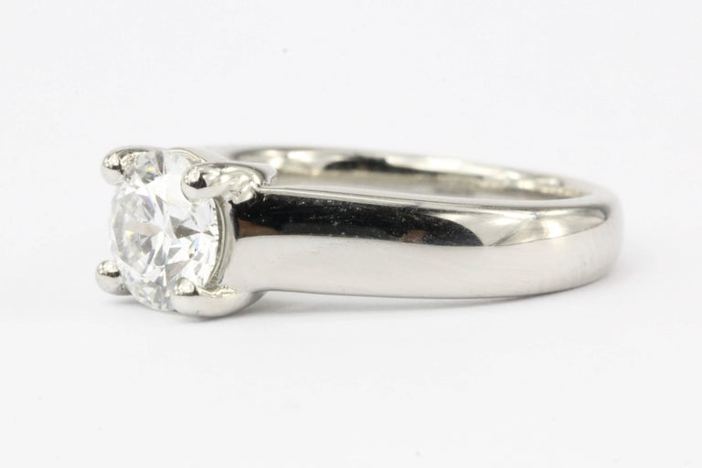 Hallmarks: PLAT  Composition: Platinum  Primary Stone: Round Brilliant Cut Diamond  Stone Carat: 1.12 Carats  Color / Clarity: D / Vs2  Ring Face: 7mm  Rise Above Finger: 7mm  Ring Size: 5  Ring Weight: 10 grams  Ring Condition: Excellent estate