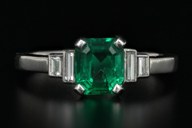 Era: Modern  Hallmarks: BPR  Composition: Platinum  Primary Stone: Natural Columbian Emerald  Stone Carat: 1.28 Carat  Accent Stone: Diamond  Accent Stone Carat: .36 Carat  Color / Clarity: G/H-Vs1/2  Total Carat Weight: 1.64 CTW  Ring Width: