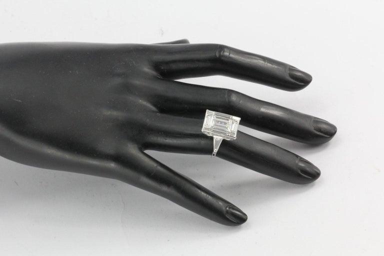 Era: Modern  Hallmarks: 10% IRID PLAT  Composition: Platinum  Primary Stone: Diamond  Stone Carat: Approximately 1.5 carats  Color / Clarity: I / VS2  Shape: Rectangle Baguette  Color/Clarity: H/I - VS1/2  Secondary Diamond Weight: Approximately