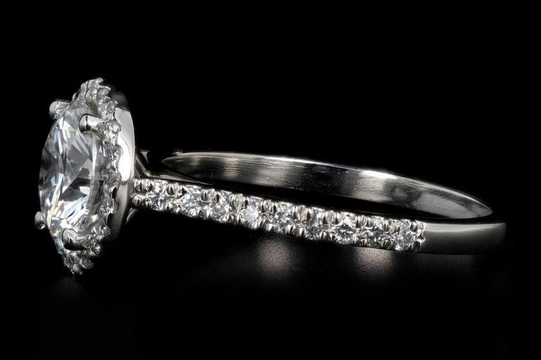 Round Cut Platinum 1.56 Carat Round Brilliant Cut Diamond Halo Engagement Ring For Sale