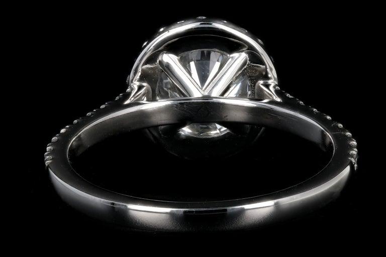 Women's Platinum 1.56 Carat Round Brilliant Cut Diamond Halo Engagement Ring For Sale