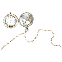 Platinum, 18 Karat Gold and Diamond World Pendant Watch Necklace