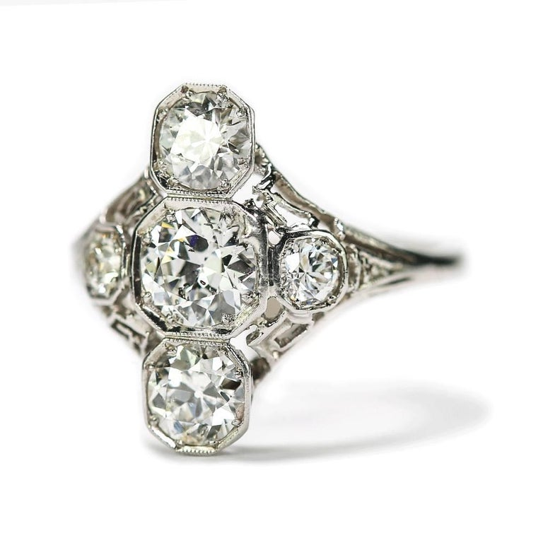 A superb original Art Deco platinum and 18k white gold antique diamond ring.  This is a fine example of design from the glamorous 1920s/30s era. This stunning vintage diamond ring comprises an estimated 2.10cts of old European cut diamonds with the