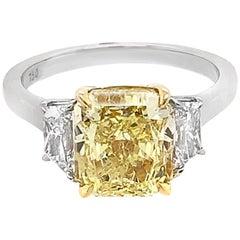 Platinum, 18K White Gold 3.58 CT Radiant Cut 0.86 CT Trillion Cut Diamond Ring