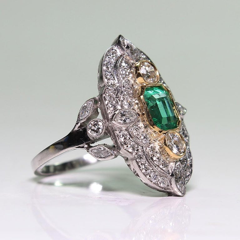 For sale is a platinum and 18K yellow gold Art Deco Emerald and diamond ring! Showcasing 56 Marquise brilliant cut and old European cut diamonds with various measurements weighing a total of 1.51 carats Diamond Grading: Color Grade: H–I-J. Clarity