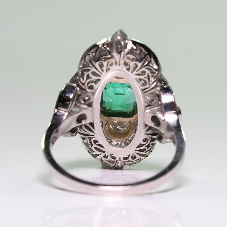 Women's Platinum and 18 Karat Yellow Gold Art Deco Emerald and Diamond Ring For Sale