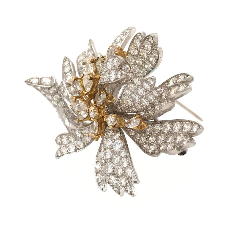 Beautiful diamond pin crafted in platinum and yellow gold. Set with round and pear shape diamonds. Diamonds: G-H color, VS clarity and about 10.00cts in total weight.
