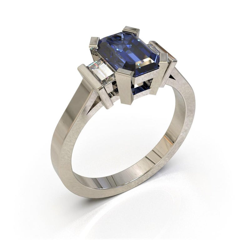 Ceylon Zaffiro Ring  Art Deco style, this elegant ring is made in platinum and set with a stunning Ceylon sapphire with a pair of baguette diamonds on either side.  Emerald faceted sapphire: Medium light strong blue. Eye Clean, Ceylon origin, 7.80 x