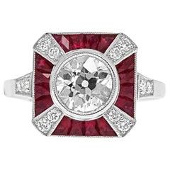 Platinum 1.07 Carat Center Round Diamond and Ruby Ring