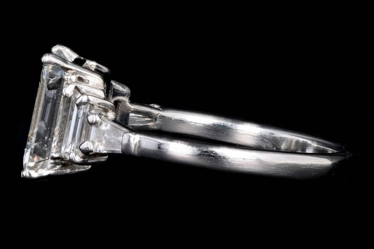 Women's Platinum 2.03 Carat Emerald Cut Diamond Engagement Ring For Sale