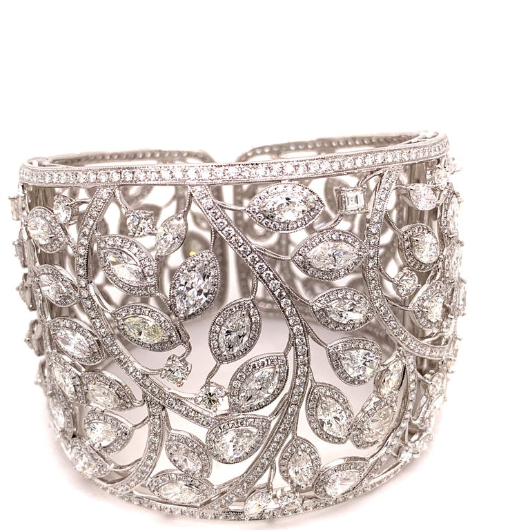 Gorgeous and creatively designed platinum marquise diamonds total weighing 24.71 carat with small diamonds with the total weight of 11.90 carat bangle