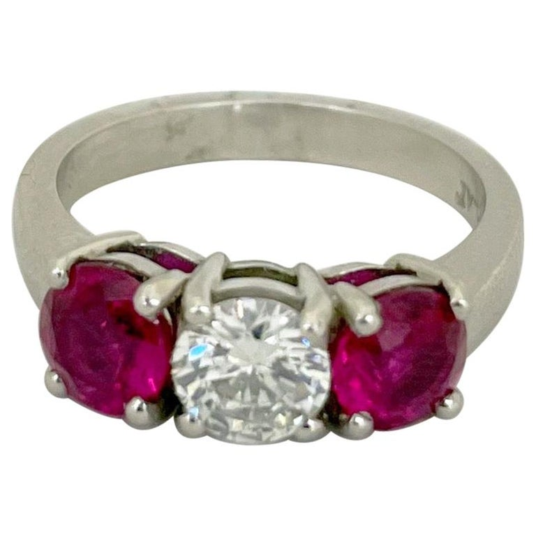Platinum 3 Stone, 1.63 Carat Ruby and .61 Carat Diamond Ring For Sale