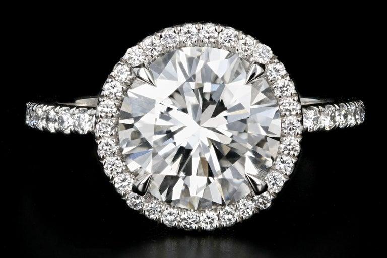 Era: New  Composition: Platinum  Primary Stone: Round Brilliant Cut Diamond  Carat Weight: 3.01 Carats  Color: H  Clarity: Vs1  Accent Stone: Round Brilliant Cut Diamonds  Carat Weight: .50 Carats  Color: G-H  Clarity: Vs  Total Carat Weight: 3.51