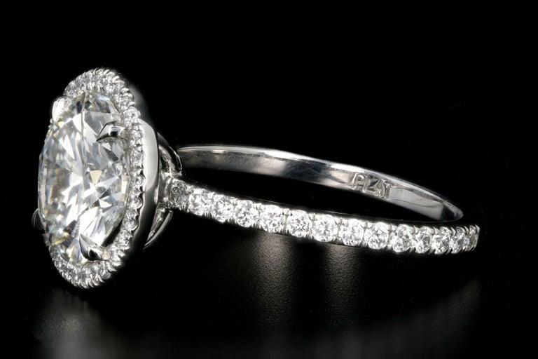 Round Cut Platinum 3.01 Carat Round Brilliant Cut Diamond Halo Engagement Ring For Sale