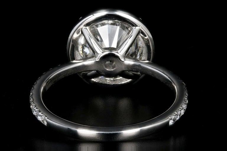 Women's Platinum 3.01 Carat Round Brilliant Cut Diamond Halo Engagement Ring For Sale