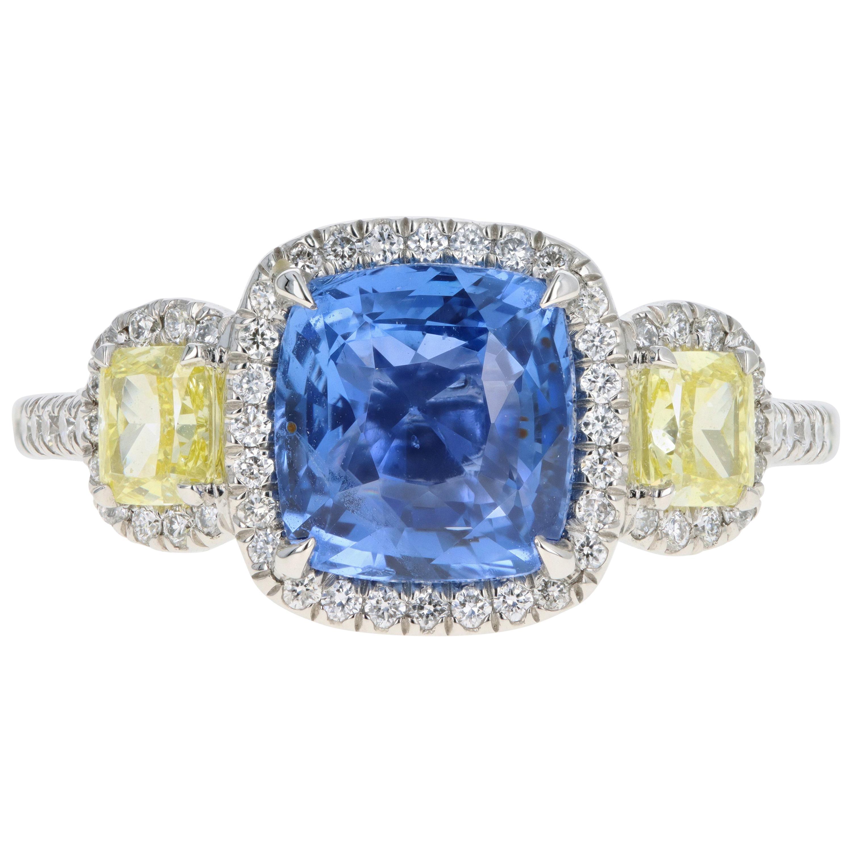 Platinum 3.15 Carat Cushion Cut Natural Ceylon Sapphire and Yellow Diamond Ring